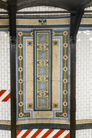 terra cotta: New York, USA - OCT 22, 2015: old vintage pattern at wall of metro station in Manhattan, USA. Intricate tiles with symbols  in terra cotta show art nouveau symbols.