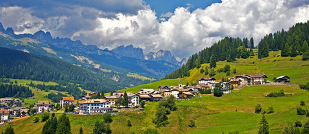 alpes: view over the meadows and agriculture in the dolomite alpes, near village Vigo Stock Photo