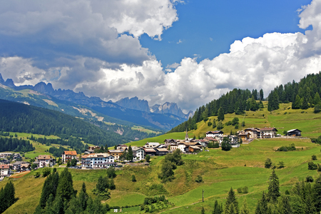 dolomite: view over the meadows and agriculture in the dolomite alpes, near village Vigo Stock Photo