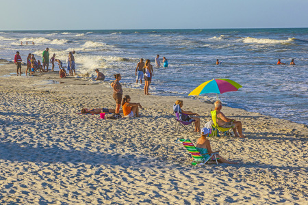 augustine: ST. AUGUSTINE, USA - JULY 23, 2010: people enjoy the beautiful beach in St. Augustine, USA. St. Augustine, Florida, was founded in 1565 and beside the historical sites famous for its beaches.