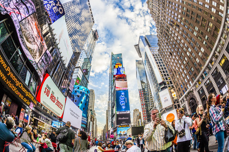 square: NEW YORK, USA - OCT 21, 2015: Times Square, featured with Broadway Theaters and huge number of LED signs, is a symbol of New York City and the United States.