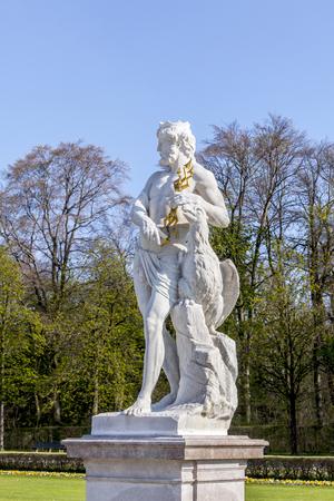 nymphenburg palace: Statue schloss Munich, Nymphenburg palace on sunny day, Germany Editorial