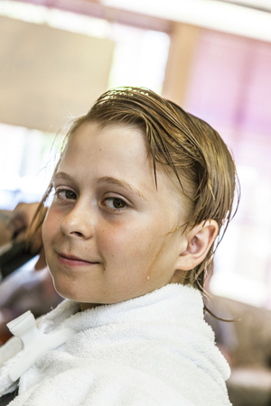 haircutter: teenage boy at the hairdresser Stock Photo