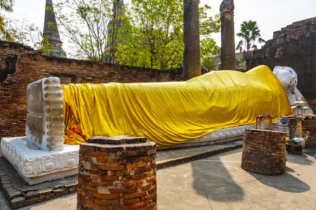ajutthaya: lying Buddha dressed in yellow scarf in temple Wat Yai Chai-mongkol Editorial