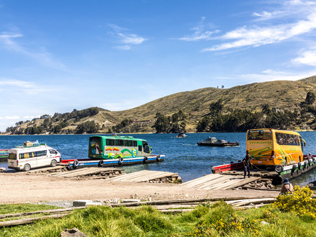 tour boats: COPACABANA, BOLIVIA - NOV 13, 2015: Many tour boats and ferries in the harbor of the small tourist town of Copacabana in a bay of Lake Titicaca  in Copacabana, Bolivia.