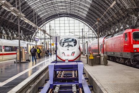 intercity: FRANKFURT, GERMANY - NOV 25, 2015: Intercity Express (ICE) train of the Deutsche Bahn (DB) at the Frankfurt central Station  in Frankfurt, Germany. The ICE runs nearly 180 km per hour.