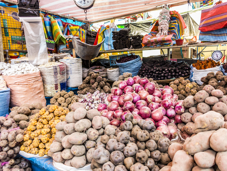 AREQUIPA, PERU - OCT 28, 2015: people sell goods at the central market in Arequipa, Peru. Central market Rio Seco is the biggest in Arequipa.