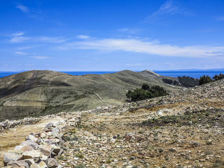 terracing: Hillside footpath with view to Titicaca lake at  Isla del Sol (Island of the Sun) Stock Photo