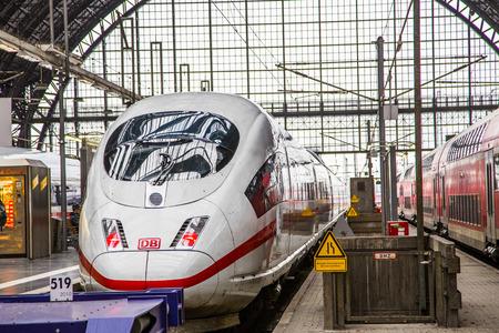 db: FRANKFURT, GERMANY - NOV 25, 2015: Intercity Express (ICE) train of the Deutsche Bahn (DB) at the Frankfurt central Station  in Frankfurt, Germany. The ICE runs nearly 180 km per hour.