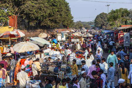DELHI - NOVEMBER 10, 2011: people at the Meena Bazaar Market in Delhi, India. Shah Jahan founded the bazaar in the 17th century inspired by the architecture of the Isfahan Bazaar. Editorial