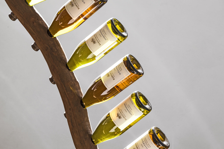 12 class: EBERBACH, GERMANY - SEP 12, 2010: Riesling wines in a wine rack at cloister Eberbach, Germany. This Winery produces first class German Riesling wines. Editorial