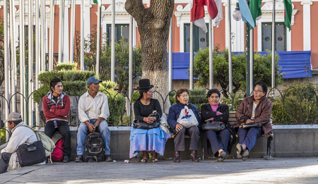 murillo: LA PAZ - BOLIVIA - NOV 17, 2015: People sit at Plaza Murillo  and Government Palace in La Paz, Bolivia. La Paz is the worlds highest administrative capital.