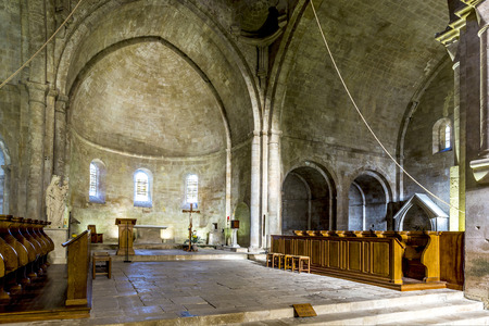 patronage: GORDES, FRANCE - DEC 10, 2015: Inside the church of  Senanque abbey. It was founded in 1148 under the patronage of Alfant, bishop of Cavaillon, and Ramon Berenguer II, Count of Provence.