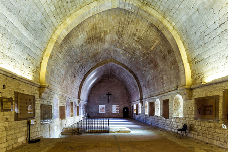 patronage: GORDES, FRANCE - DEC 10, 2015: Inside the cloister of Senanque abbey. It was founded in 1148 under the patronage of Alfant, bishop of Cavaillon, and Ramon Berenguer II, Count of Provence