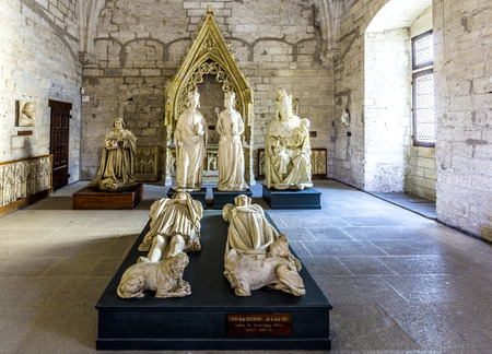 palais: AVIGNON, FRANCE - DEC 9, 2015: Inside the north Sacristy of the popes palace in Avignon, France with Plaster effigies of prominent figures during the papal rule of the palace.