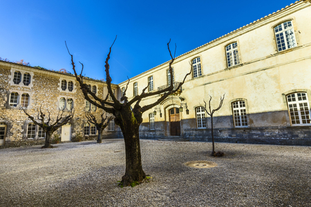 patronage: GORDES, FRANCE - DEC 10, 2015: Inside the cloister square of  Senanque abbey. It was founded in 1148 under the patronage of Alfant, bishop of Cavaillon, and Ramon Berenguer II, Count of Provence.