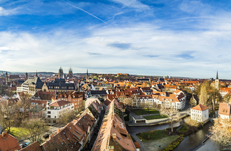 erfurt: ERFURT, GERMANY - DEC 20, 2015: skyline of old town of Erfurt, Germany. Erfurt facade of old socialist buildings are renovated with more colorful facades in erfurt, Germany. Erfurt was first mentioned in 742, as Saint Boniface founded the diocese.