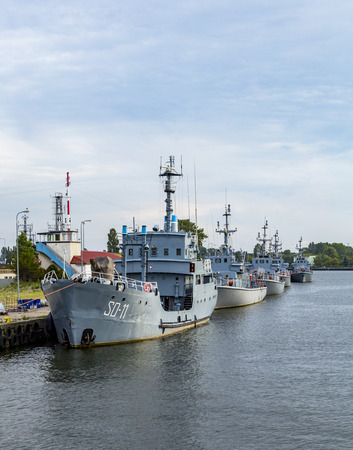 harbors: SWINEMUENDE, POLAND - AUG 12, 2015: marine harbor in Swinemuende, Poland. The marine battleship harbor exists since the first world war and is one of the tree polish marine harbors.
