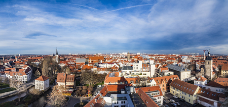 mentioned: ERFURT, GERMANY - DEC 20, 2015: skyline of old town of Erfurt, Germany. Erfurt facade of old socialist buildings are renovated with more colorful facades in erfurt, Germany. Erfurt was first mentioned in 742, as Saint Boniface founded the diocese.