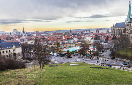 largest: ERFURT, GERMANY - DEC 20, 2015: famous christkindl market in Erfurt, Germany. The Christmas Market is one of the loveliest in the whole of Germany and the largest in Thuringia.