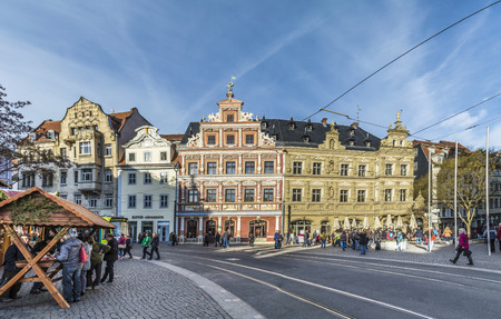 mentioned: ERFURT, GERMANY - DEC 20, 2015: people at one of the central streets of the city of Erfurt, Germany. Erfurt is the Capital of Thuringia and the city was first mentioned in 742.