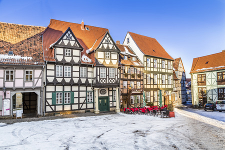existed: QUEDLINBURG, GERMANY - JAN 8, 2016: scenic old half timbered houses in Quedlinburg, Germany. The town  is known to have existed since at least the early 9th century. Editorial