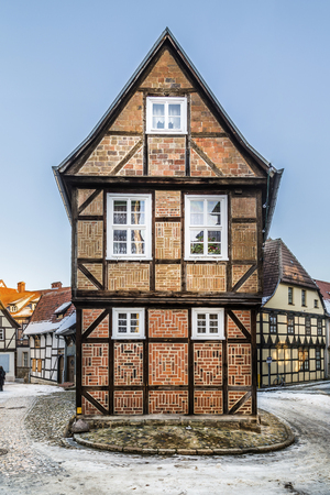 half timbered: QUEDLINBURG, GERMANY - JAN 8, 2016: scenic old half timbered houses in Quedlinburg, Germany. The town  is known to have existed since at least the early 9th century. Editorial