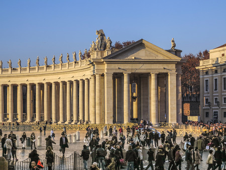internationally: VATICAN CITY,VATICAN - DEC 23, 2015 : Tourists on foot Saint Peters Square in Vatican.It is the smallest internationally recognized independent state in the world, Jan 6, 2015 in, Vatican. Editorial