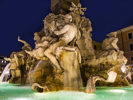 bernini: Rome - Piazza Navona and Fontana dei Fiumi by Bernini at night, Italy