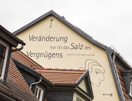lived here: RUDOLSTADT, GERMANY - JAN 10, 2016: proverb of Friedrich Schiller at a house wall in old town of Rudolstadt in Thuringia, Germany. Rudolstadt is also called Schillerstadt as the author lived here in 1787. Editorial