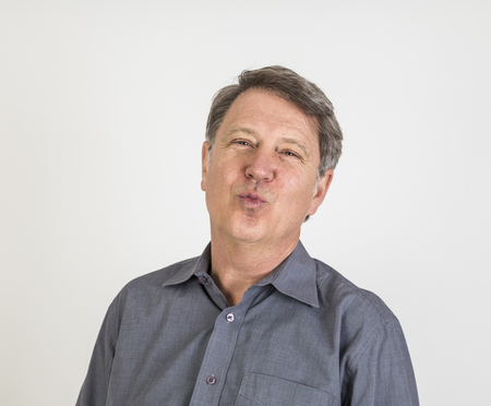 air kiss: attractive man gives a kiss in the air