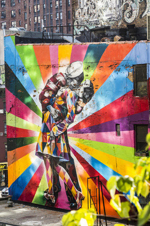 end times: NEW YORK CITY, USA - OCT 21, 2015: mural the Kiss at an old brick facade in New York, USA. The couple in the 1945 photograph were revealed to be  George Mendonsa and Greta Friedman.