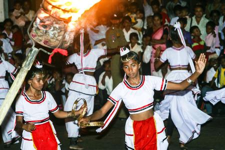kandy: KANDY, SRI LANKA - AUG 10, 2005: dancers participate the festival Pera Hera in Kandy to celebrate the tooth of Buddha in Kandy, Sri Lanka.