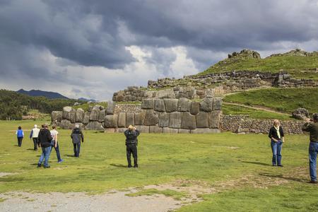 incan: QUZCO, PERU- JAN 16, 2015: people visit the ancient sacsayhuaman walls, an old incan fortress near Cuzco, Peru. Editorial