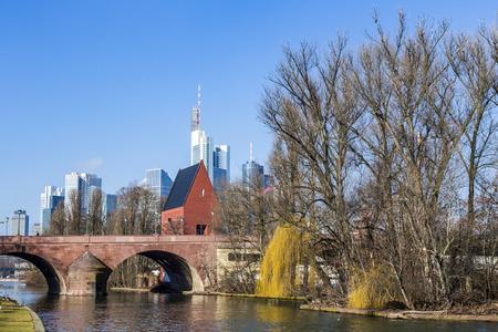 river main: skyline of Frankfurt an Main with old historic bridge at river Main Editorial