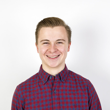 sixteen: portrait of cute sixteen year old boy in studio Stock Photo