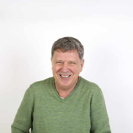 laughing face: portrait of friendly happy laughing mature man