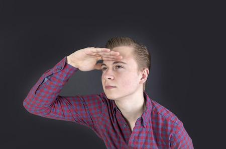 far: portrait of cute sixteen year old boy in studio  looking into the far