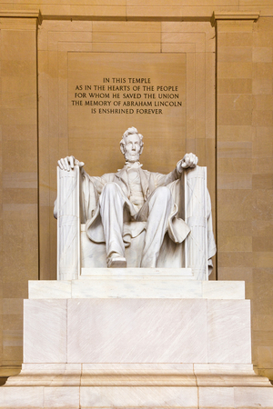 stitting: Statue of AbrahamLincoln in Memorial in Washington Editorial