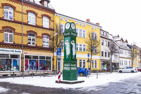 17 years: MUEHLHAUSEN, GERMANY - JAN 17, 2016: old clocktower with advertising for washing powder in snow in Muehlhausen, Germany. The ads are more than 100 years old and symbolize the years at beginning of last century.