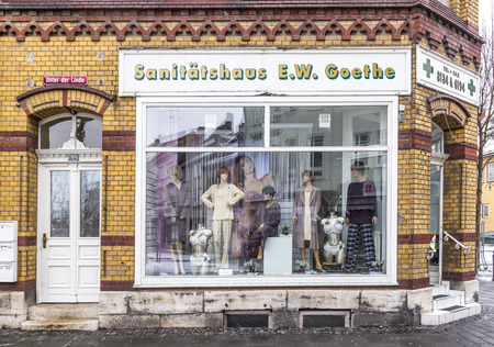 MUEHLHAUSEN, GERMANY - JAN 17, 2016: old shop window of a medical supply store with the name of Goethe in Muehlhausen, Germany. Goethe is for Thuringia a touristic brand.