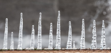icicled: pattern of ice crystal hanging un a peace of wood