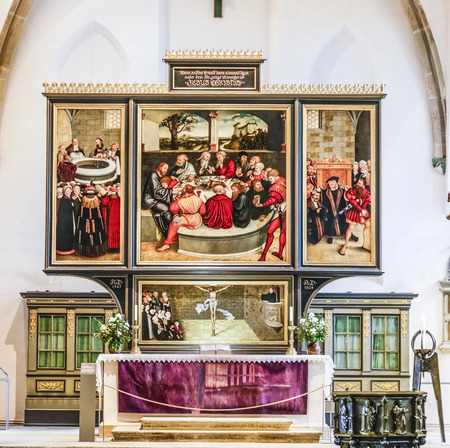 lucas: WITTENBERG, GERMANY - MAR 25, 2016:  famous altar from Lucas Cranach in the civic church in Wittenberg, Germany. The first mention of the Pfarrkirche St.-Marien dates to 1187.