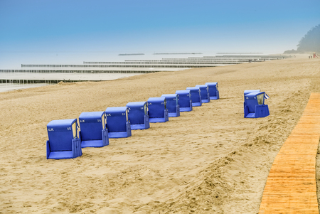 beach chairs: beach with typical beach chairs of baltic sea in the evening Stock Photo