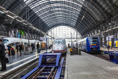 departing: FRANKFURT, GERMANY- MAR 25, 2015: People arriving or departing at the Frankfurt main train station, Hauptbahnhof in Frankfurt, Germany.
