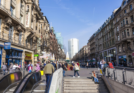 street drug: FRANKFURT, GERMANY- MAR 25, 2015: people in the Kaiserstrasse in front of  Frankfurt train station. The train station area is the most dangerous place due to crime, drugs and alcohol in Frankfurt. Editorial