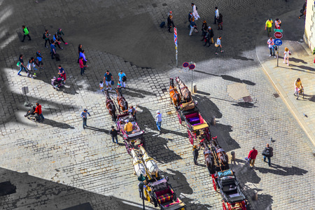 stephansplatz: VIENNA - APR 27, 2015: Aerial view of Stephansplatz with tourists and fiakers in Vienna, Austria. Several popular pedestrian routes begin here and a lot of tourists visit this place.