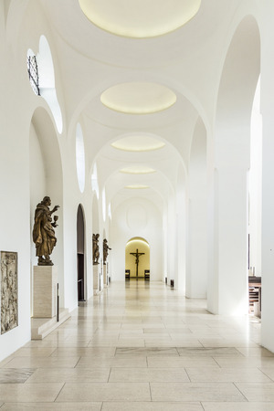diffuse: AUGSBURG, GERMANY - APR 24, 2015: British architect John Pawsons minimalist remodelling of St. Moritz church in Augsburg, Germany, includes slices of onyx over the windows to diffuse light more softly through the space.