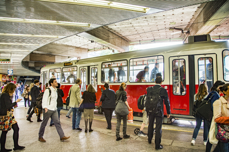 electric tram: VIENNA, AUSTRIA - APR 27, 2015: people waiting for streetcar at Schwedenplatz in Vienna. On January 28, 1897, an electric tram operated for the first time in Vienna on the tracks of todays line 5.