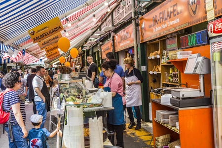 producer: VIENNA, AUSTRIA - APR 28, 2015: people enjoy the Naschmarket in Vienna. Since the 16th century people in Austria has come to the Naschmarkt get to enjoy the many different products from local producer.